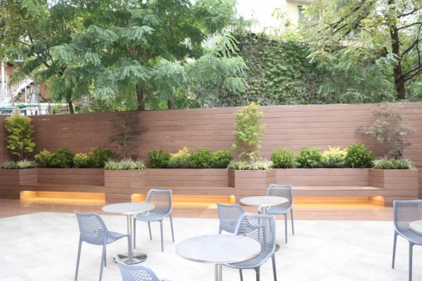 Brooklyn_nyc_courtyard_landscape_trex_composite_planters_green_roof_design_trees_decking_custom_woodwork_nursing_home_accessible
