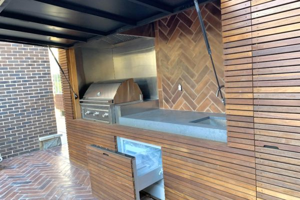 tier ii _private_ residential_backyard_IPE_woodwork_build_courtyard_brooklyn_nyc_landscape_fireplace_trees_kitchen_outdoor_kitchen_stainless_steel_unique_beautiful_extraordinary_flooring_fridge