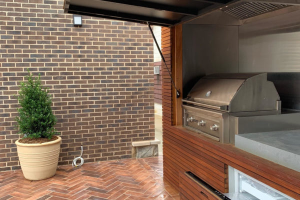 tier ii _private_ residential_backyard_gardens_design_landscapoig_IPE_woodwork_build_courtyard_brooklyn_nyc_landscape_fireplace_trees_kitchen_outdoor_kitchen_stainless_steel_unique_beautiful