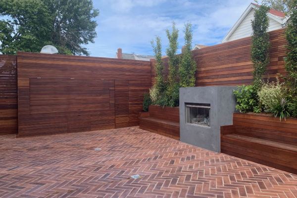 tier ii _private_ residential_landscapoig_IPE_woodwork_build_courtyard_brooklyn_nyc_landscape_fireplace_trees_kitchen_outdoor_kitchen_stainless_steel_unique_beautiful_extraordinary_flooring_fire