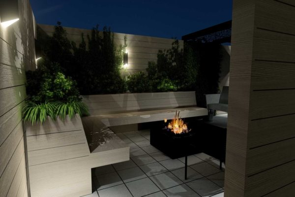 Custom bench planters, wall sconce lighting, and fire pit table, night shot
